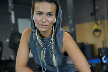 Woman in a gym resting between workouts