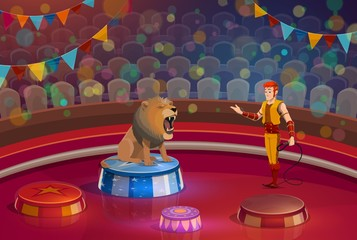 Lion with open mouth and handler on circus stage
