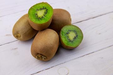 Kiwi fruits on white wooden table