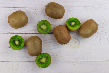 Kiwi fruits on white wooden table. Top view