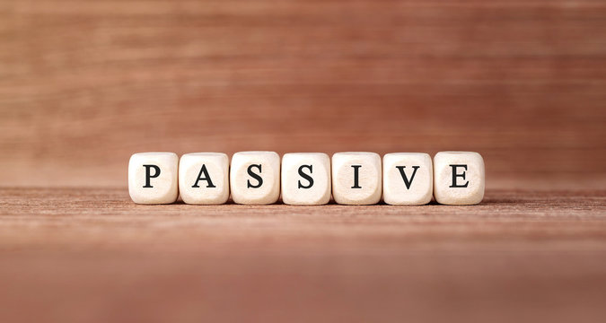 Word PASSIVE made with wood building blocks