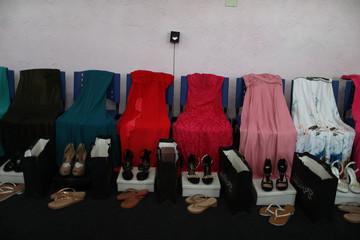 """Dresses for prisoners who participate in the """"Garota TB"""" beauty contest at the Talavera Bruce women prison in Rio de Janeiro"""
