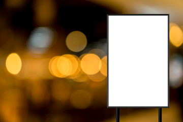 mock up blank white poster standing on blur restaurant background for show or promote promotion