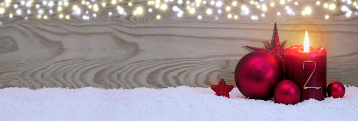 Second Advent. Christmas background with candle and red bauble .