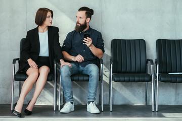 woman touching mans knee. work harassment flirt and seduction.