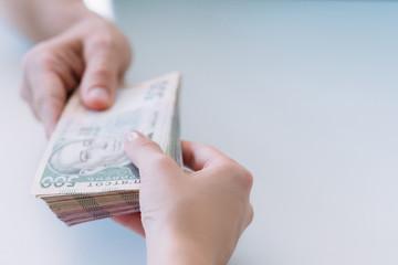hands holding bundle of money. cash payment and bribery. 500 ukrainian hryvnia bills