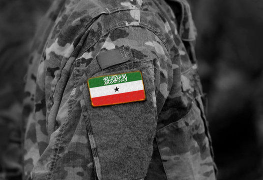 Flag of Somaliland on soldiers arm. Somaliland flag on military uniform. Army, troops, Africa (collage).