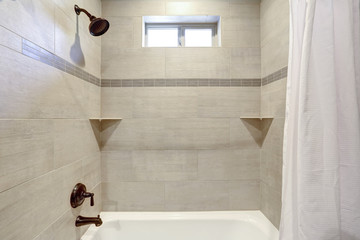 White bathroom interior with ivory subway tile.