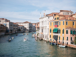 VENICE, ITALY, NOV 1st, 2018: Grand Canal or Channel and colorful facades of old medieval houses. Classic Venezia or Venice panoramic cityscape