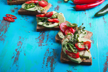 Avocado toasts with fresh vegetables
