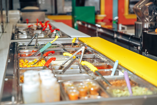 Trays with food on showcase at cafe. Food trays in a snack bar