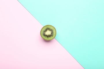 Sweet kiwi fruit on colorful background
