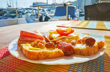 Enjoy the breakfast on yacht with delcious sandwiches and scenic seascapes, Valletta, Malta.
