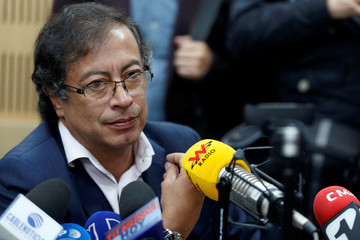 Senator Gustavo Petro reacts during a radio interview as he explains the origin of a cash he received in 2005, in Bogota