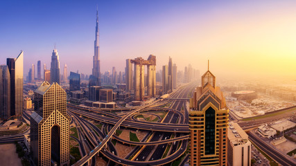 Dubai skyline at sunset, panoramic aerial top view to downtown city center landmarks. Famous viewpoint, United Arab Emirates