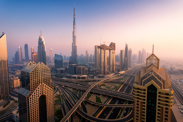Dubai skyline at sunset, aerial top view to downtown city center landmarks. Famous viewpoint, United Arab Emirates