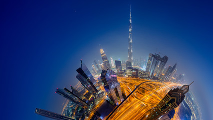 Dubai skyline at night, Little Planet effect. panoramic aerial top view to downtown city center landmarks
