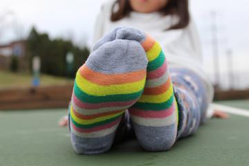 Girl's feet in striped socks