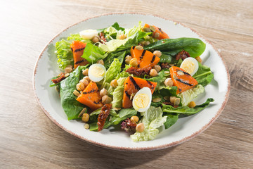 Fresh salad with grill pumpkin