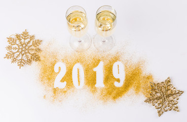 2019. Inflatable Gold Numbers on the Background of the white Stone Wall New Year