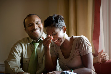 Laughing mid-adult couple.