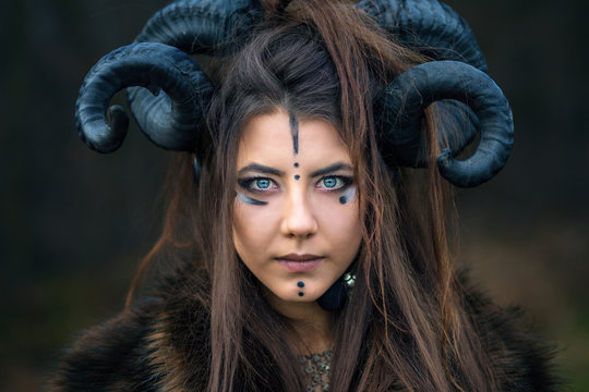 Outdoor Portrait Of Beautiful Scandinavian Viking Woman Warrior With Blue Eyes Wearing Ram Horns Looking At Camera Female Hunter With Specific Makeup Wearing Fur Collar Buy This Stock Photo And Explore