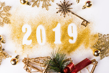 Creative background, 2019 Happy new year. Gold Numbers Design of greeting card of. Gold Shining Pattern. Happy New Year Banner with 2019 Numbers on white background. Confetti, copy space.