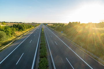 empty german highway with stray light from the sun