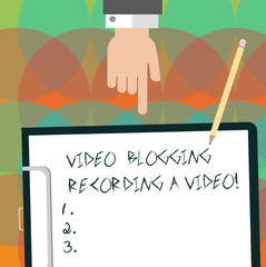 Conceptual hand writing showing Video Blogging Recording A Video. Business photo text Social media networking blogger influence Hu analysis Hand Pointing Down to Clipboard with Paper and Pencil