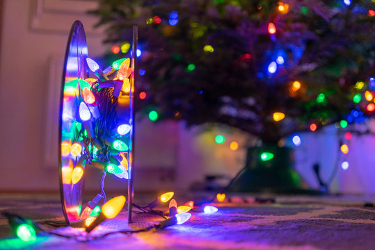 Roll of Christmas Lights with Christmas tree  in Backgroun - Bokeh Lights