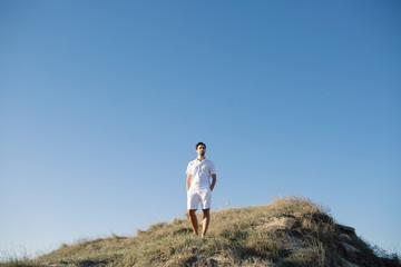 Man on hilltop