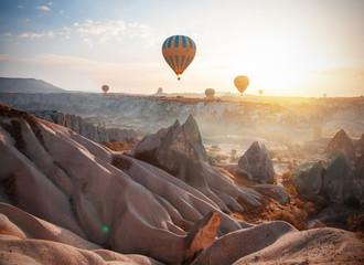 Hot air balloon flying over Cappadocia, Turkey Wall mural