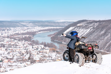 Travel in the winter on the ATV. Beautiful winter nature.