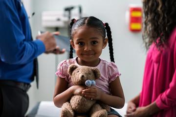 Exam: Little Girl Happy To Get Lollipop From Doctor