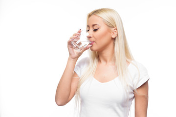 Healthy blond woman  holding and drink glass of water on isolated white background