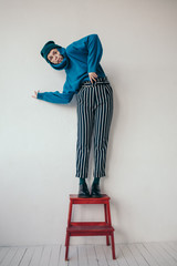 Fashionable woman posing on steps