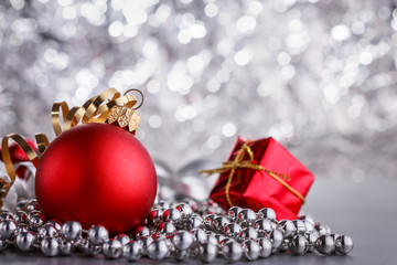 Christmas composition of Christmas tree toys on a blurred silver background