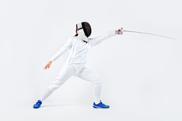 Young fencer athlete wearing mask and white fencing costume. holding the sword. Isolated on white background