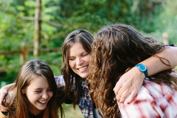 Happy Mother and Two Daughters Laughing