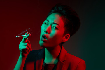 Smoking woman in neon illumination