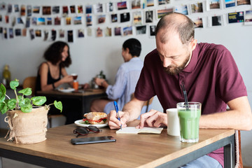 Man working in cafe