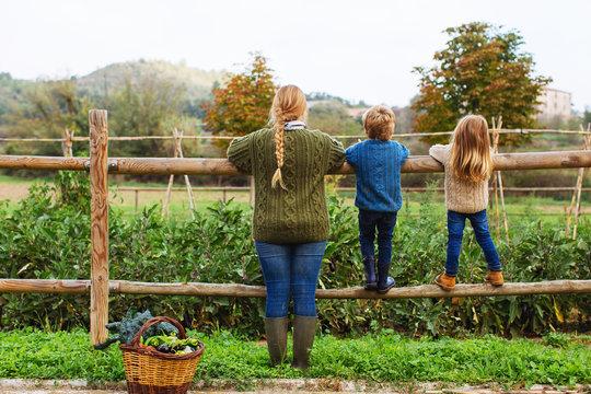 Back view of mom and her kids on their orchard.