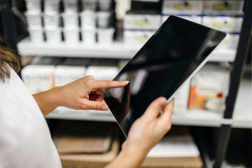 Pharmacist working with a digital tablet