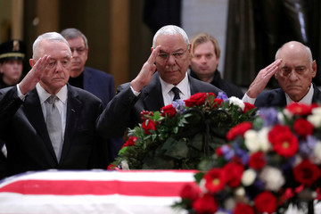 U.S. former Secretary of State Powell leads retired military leaders in a salute as the body of former U.S. President Bush lies in state in the Rotunda at the U.S. Capitol in Washington
