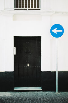 Black door and direction arrow