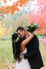Couple Kissing in Autumn Forest