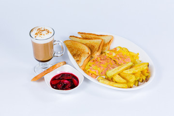 breakfast with toasts, scrambled eggs, cappuccino and french fries