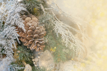Christmas background - branches, toys, highlights. Place for congratulations.