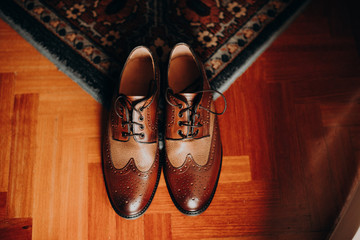 Men's shoes on a rug