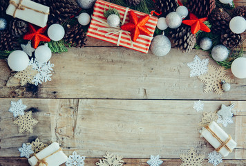 Christmas background with gift boxes and decorations on the wood
